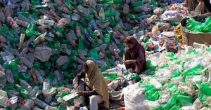 Labourers separate bottles by colour at a plastic recycling factory in Lahore Dec 7, 2012